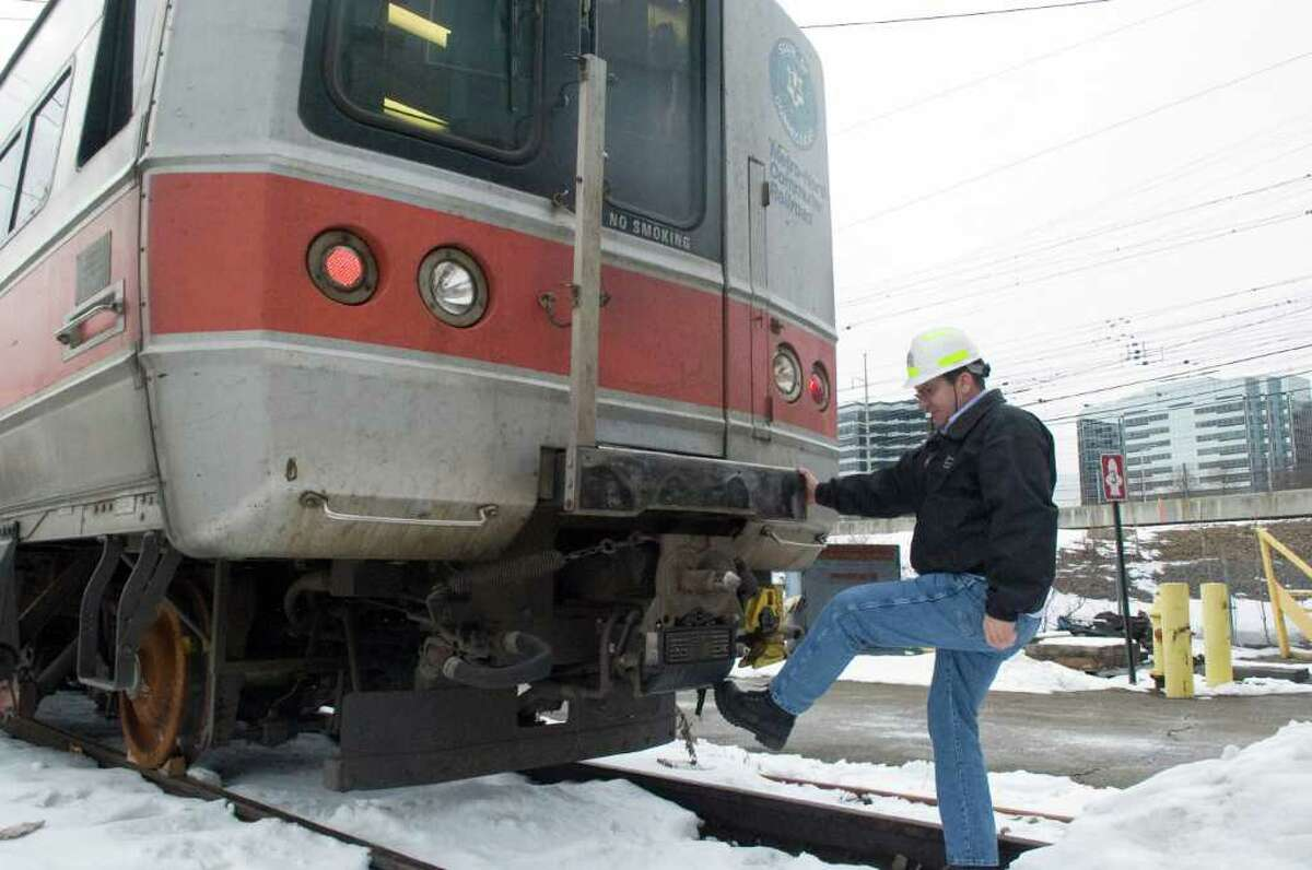 Metro North Superintendent Pashko Kinic checks the electrical connector on a train as he prepares for the storm at Stamford Rail Maintenance Shop in Stamford, Conn., Tuesday, January 11, 2011.