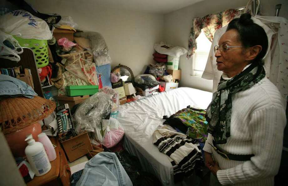 Carleen McDowell shows the most cluttered bedroom in her apartment at 95A Yaremich Drive in Bridgeport. McDowell, 74, hopes to donate most of her possessions to charity so that she can most into senior housing in Pennsylvania. Photo: Brian A. Pounds / Connecticut Post