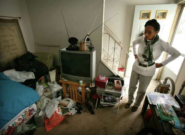 Carleen McDowell Looks At Her Cluttered Living Room In Apartment 95A Yaremich Drive