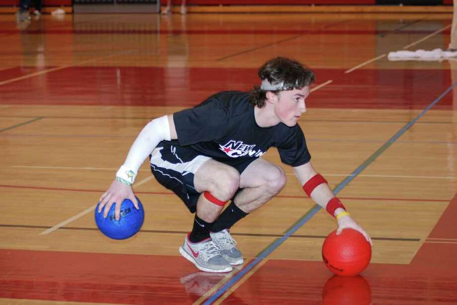 Henry Corcoran looks for his first target during the Pura Vida Dodgeball fundraiser in the NCHS gym. Photo: Jeanna Petersen Shepard / New Canaan News