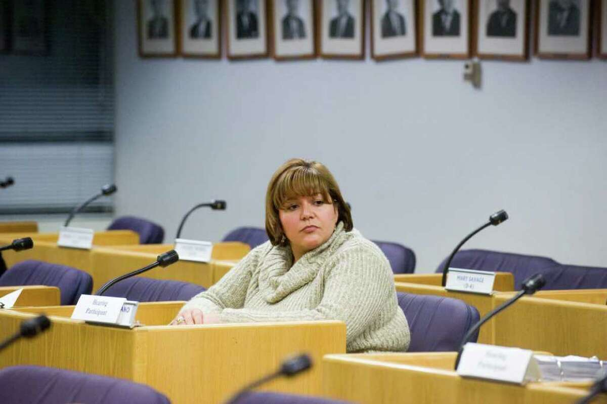 City human resources generalist Tania Barnes takes the stand as the Board of Ethics holds its second hearing in the complaint Barnes filed against Republican Board of Finance Chairman Joe Tarzia, right, at the Government Center in Stamford, Conn., Monday, January 10, 2011.