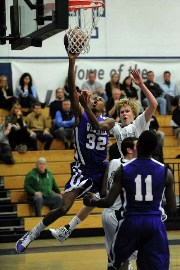 Westhill's #32 Chris Walters lays up for two points during boys basketball action against Staples in Westport, Conn. on Tuesday January 11, 2011. Photo: Christian Abraham / Connecticut Post
