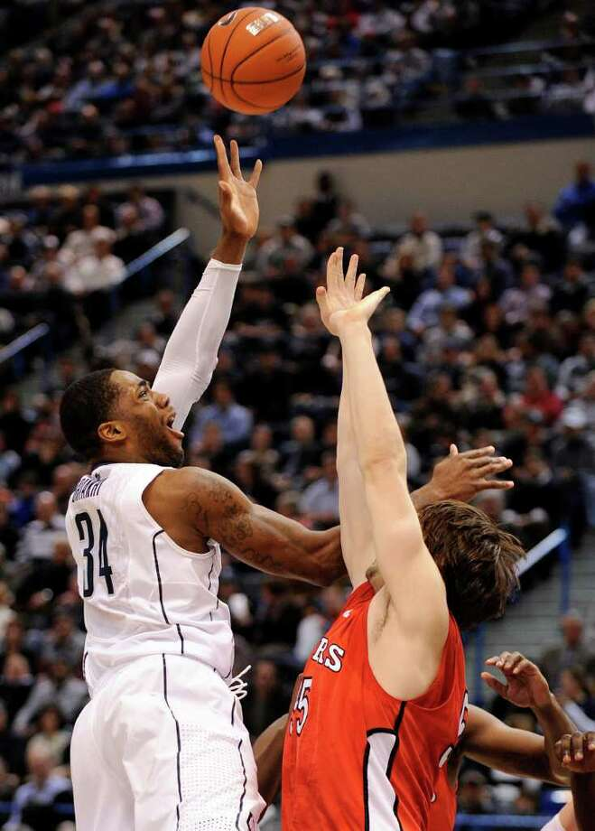 Connecticut's Alex Oriakhi shoots against Rutgers' Gilvydas Biruta during the first half of an NCAA college basketball game in Hartford, Conn., on Tuesday, Jan. 11, 2011. (AP Photo/Fred Beckham) Photo: AP