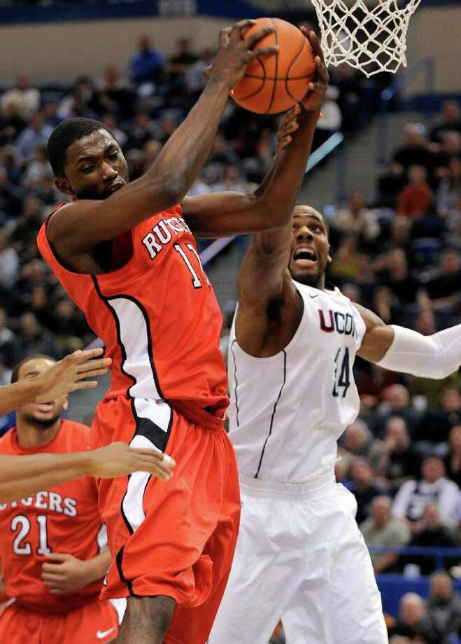 Rutgers' Dane Miller, left, and Connecticut's Alex Oriakhi go up for a rebound during the first half of an NCAA college basketball game in Hartford, Conn., on Tuesday, Jan. 11, 2011. (AP Photo/Fred Beckham) Photo: AP