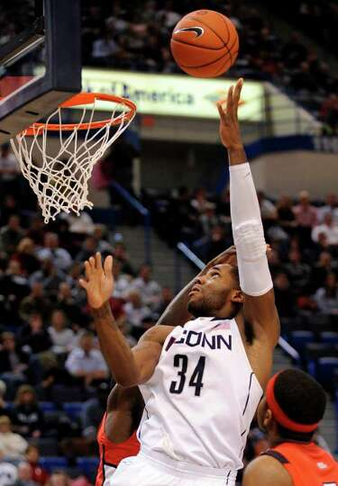 Connecticut's Alex Oriakhi scores during Connecticut's 67-53 victory over Rutgers in an NCAA college