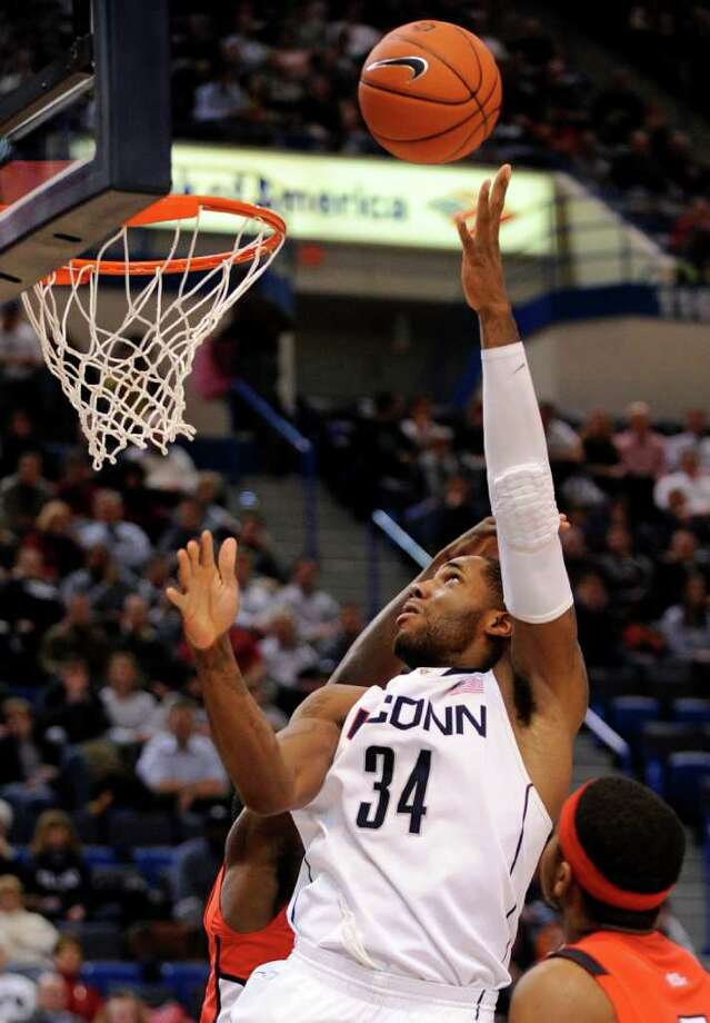Connecticut's Alex Oriakhi scores during Connecticut's 67-53 victory over Rutgers in an NCAA college basketball game in Hartford, Conn., on Tuesday, Jan. 11, 2011. Oriakhi also had 12 rebounds. (AP Photo/Fred Beckham) Photo: AP
