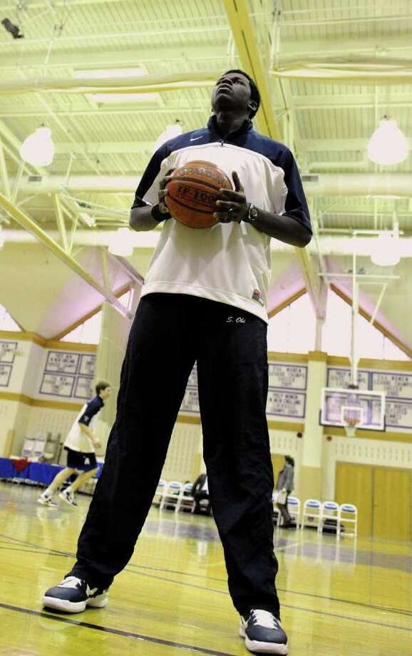 """Greens Farma Academy's 6'9"""" forward Sean Obi, warms up before a game against Chase Collegiate in Westport, Conn. on Tuesday January 11, 2011. Photo: Christian Abraham / Connecticut Post"""