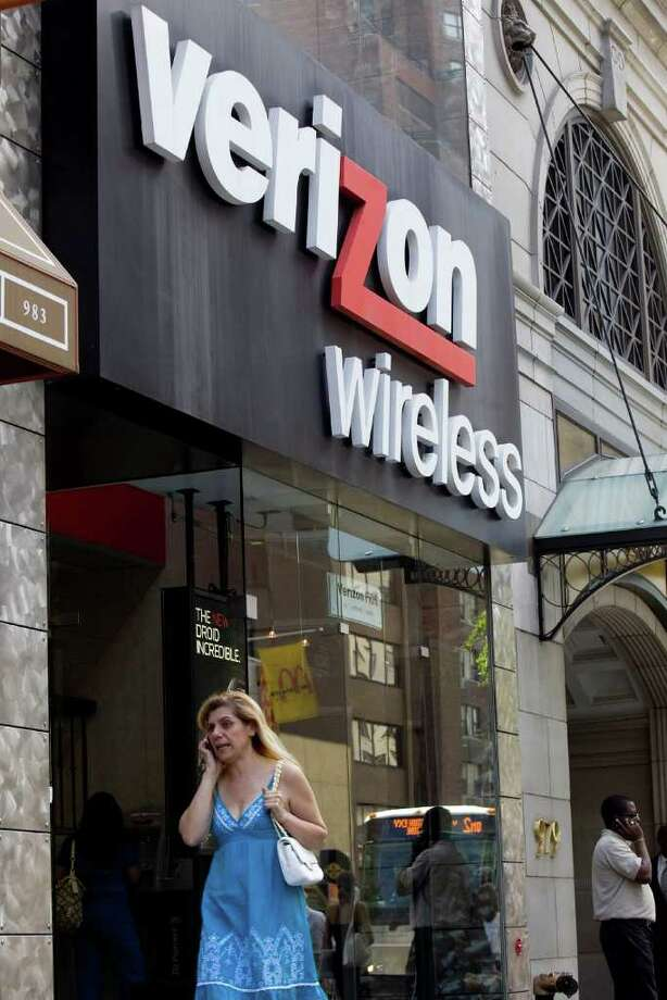 A woman speaks on a mobile phone outside a Verizon Wireless store in New York in this file photo. Verizon Wireless, set to get Apple Inc.'s iPhone this month after four years of waiting, may spend $3 billion to $5 billion to subsidize customer purchases of the device this year, cutting into profits, analysts say. Photographer: Daniel Acker/Bloomberg Photo: Daniel Acker, Bloomberg / © 2010 Bloomberg Finance LP