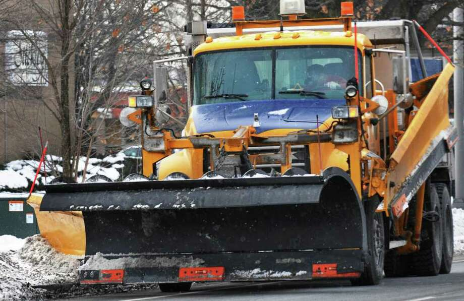 A snowplow cleans up snow-covered curbs along Wolf Road in preparation for this week's predicted storm in Colonie Tuesday January 11, 2011.   (John Carl D'Annibale / Times Union) Photo: John Carl D'Annibale / 10011715A