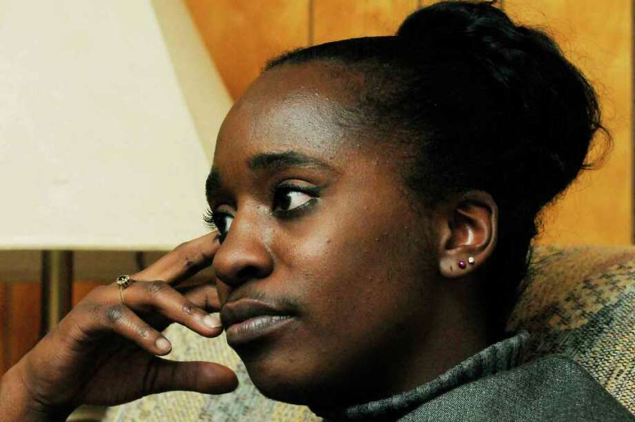 Tamera Jackson listens as her father, James Jackson, talks about her DWI arrest and conviction at their home in Colonie Thursday afternoon Jan. 6, 2011.( Michael P. Farrell/Times Union ) Photo: Michael P. Farrell