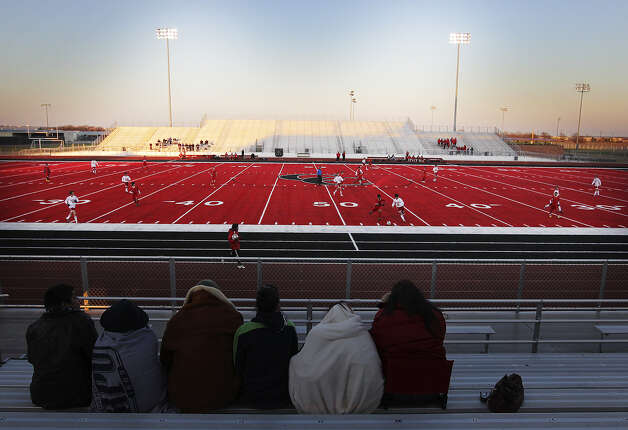 New Braunfels Canyon unveiled the new synthetic turf at Cougar Stadium Monday and it's going to leave everyone seeing red — literally. Photo: Kin Man Hui/kmhui@express-news.net