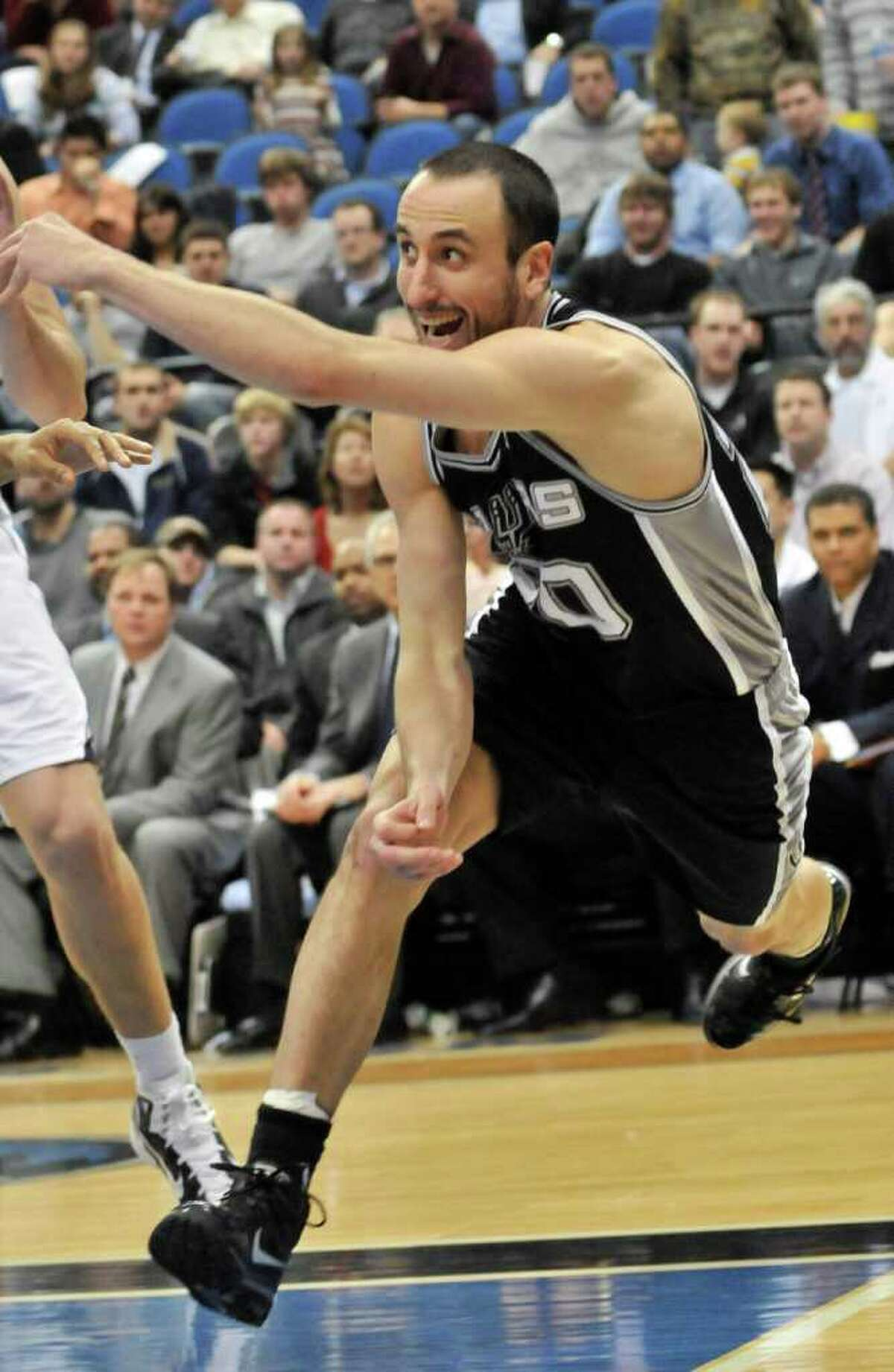 San Antonio Spurs' Manu Ginobili watches his pass against the Minnesota Timberwolves during the second half of an NBA basketball game Tuesday, Jan. 11, 2011, in Minneapolis. The Spurs won 107-96. Ginobili scored 19 points.