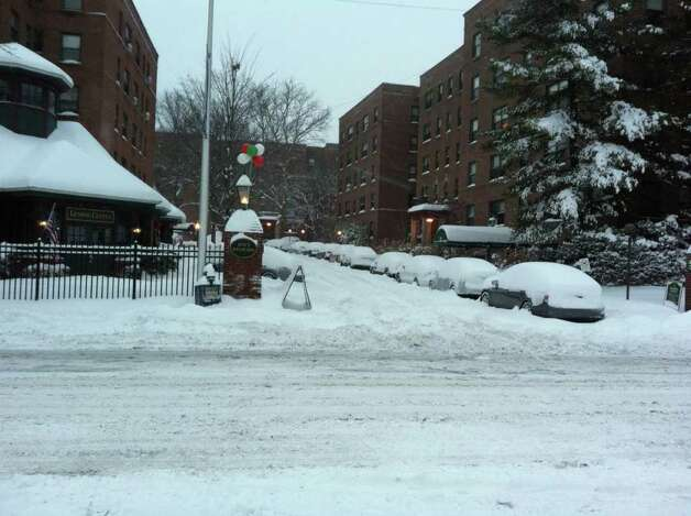 Cars are snowed in at the Bedford Hoyt condo complex in Stamford on Wednesday, Jan. 12, 2011. Photo: John Nickerson / Stamford Advocate