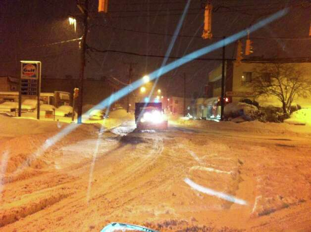 A plow makes its way down Glenbrook Road in Stamford on Wednesday, Jan. 12, 2011 as blizzard-like conditions pelted Southwestern Connecticut. Photo: John Nickerson / Stamford Advocate
