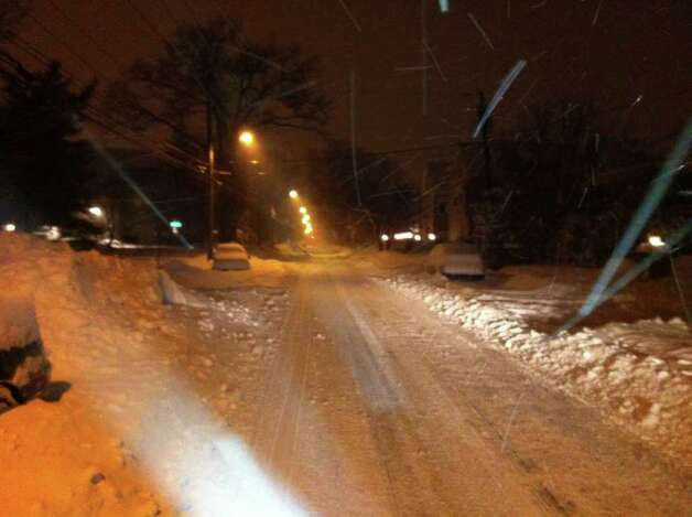 Snow covers cars on Maple Tree Ave. in Stamford early on Wednesday, Jan. 12, 2011. Photo: John Nickerson / Stamford Advocate