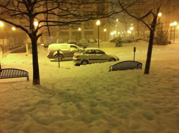 Cars stop at a stoplight early Wednesday morning, Jan. 12, 2011 in Bridgeport as heavy snow began to fall on the area. Photo: Ben Doody / Connecticut Post