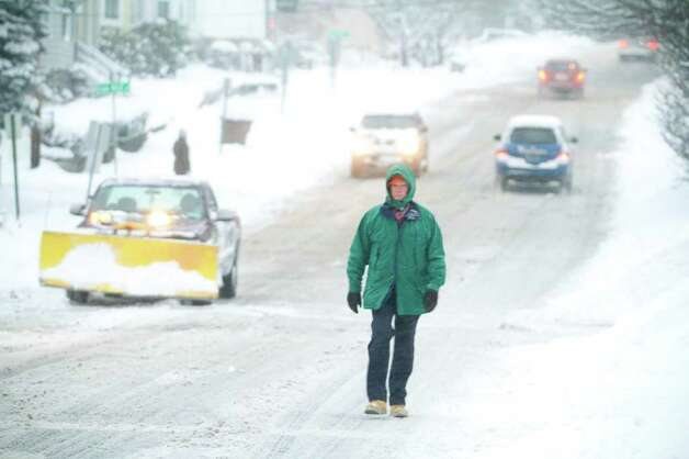 Deputy Fire Cheif Timothy Conroy walks to work in downtown Stamford from his home in Old Greenwich during a snow storm in Stamford, Conn. on Tuesday, Jan. 12, 2011. Photo: Contributed Photo / Stamford Advocate Contributed
