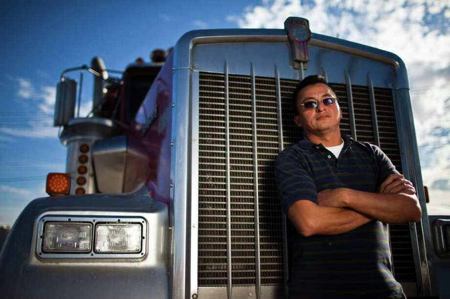Salvador Gutierrez, a native of El Salvador, drives his Kenworth 18-wheel truck for a living.  Eric Kayne/Houston Chronicle / Freelance