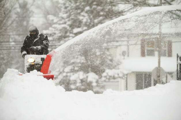 A worker at Hart School operates a snow blower during a snow storm in Stamford, Conn. on Tuesday, Jan. 12, 2011. Photo: Contributed Photo / Stamford Advocate Contributed