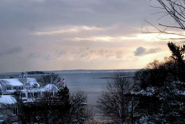 The sun breaking through the storm clouds looking south toward Long Island Sound from the bluff in Byram Park, Wednesday morning, Jan. 12. Photo: Bob Luckey / Greenwich Time