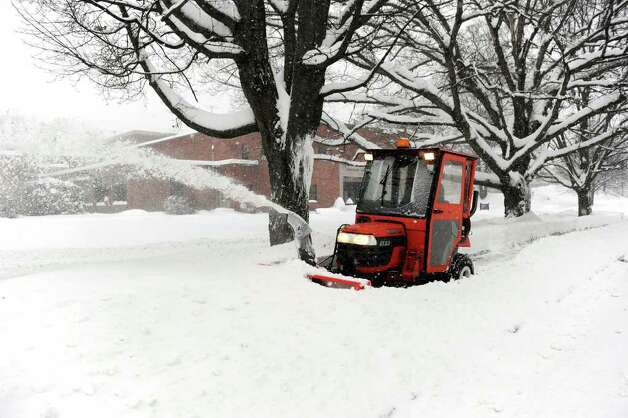 Scott Rivera plows the sidewalk on Osborne Street near Western Connecticut State University, Wednesday, January 12, 2011. 15 to 20 inches of snow fell over night in the Greater Danbury area. Photo: Carol Kaliff / The News-Times