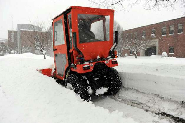 Scott Rivera plows the sidewalk on Osborne Street near Western Connecticut State University Wednesday morning. 15 to 20 inches of snow fell in the Greater Danbury area. Photo: Carol Kaliff / The News-Times