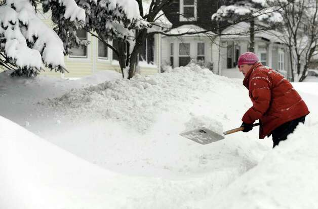 John McCarthy shovels the snow from his walk on Locust Avenue in Danbury early Wednesday morning, January 12, 2011. Photo: Carol Kaliff / The News-Times