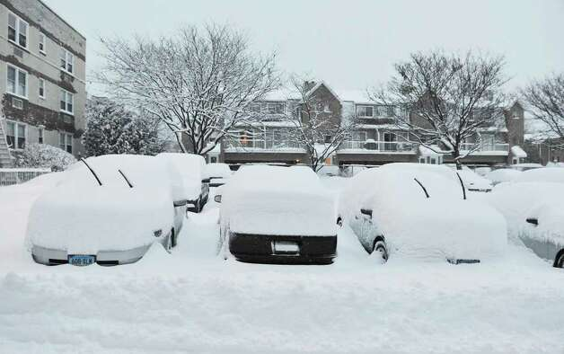 Cars sit in a parking lot plowed in Stamford, Conn. on Tuesday, Jan. 12, 2011. Photo: Kathleen O'Rourke / Stamford Advocate