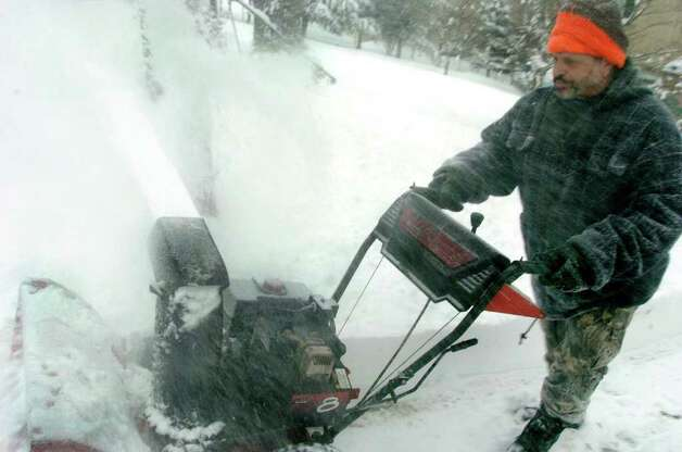 Vic Hoyt works with a snowblower to clear his Danbury driveway, Wednesday, Jan. 12, 2010. Photo: Michael Duffy / The News-Times