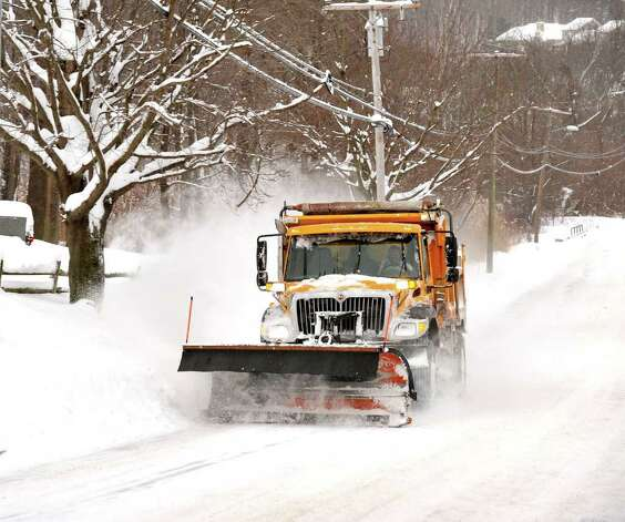 A City of Danbury plow clears Kenosia Avenue, Wednesday, Jan. 12, 2010. Photo: Michael Duffy / The News-Times