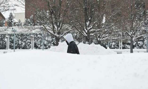 A pedestrian walks by UCONN Stamford in Stamford, Conn. on Tuesday, Jan. 12, 2011. Photo: Kathleen O'Rourke / Stamford Advocate