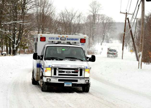 Emergency vehicles and snowplows are the only traffic on the normally busy Kenosia Avenue in Danbury during the morning rush hour, Wednesday, Jan. 12, 2010. Photo: Michael Duffy / The News-Times