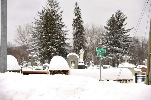 St. Peter's Cemetery in Danbury is almost lost beneath the snow, Wednesday, Jan. 12, 2010. Photo: Michael Duffy / The News-Times