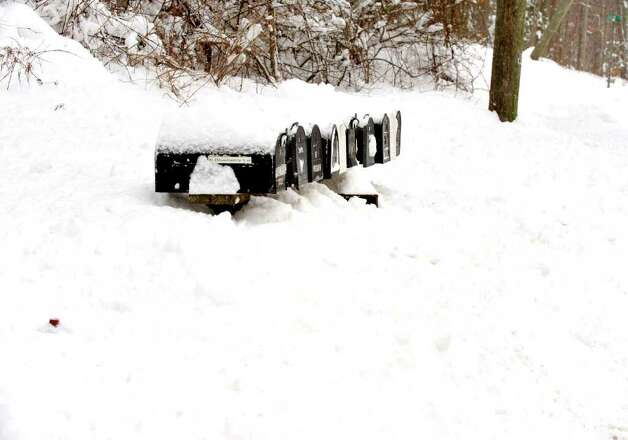 Mailboxes along Boulevard Drive in Danbury are almost lost in the snow, Wednesday, Jan. 12, 2010. Photo: Michael Duffy / The News-Times