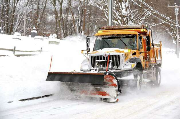 A City of Danbury plow clears Kenosia Avenue, Wednesday, Jan. 12, 2010. Photo: Michael Duffy / The News-Times