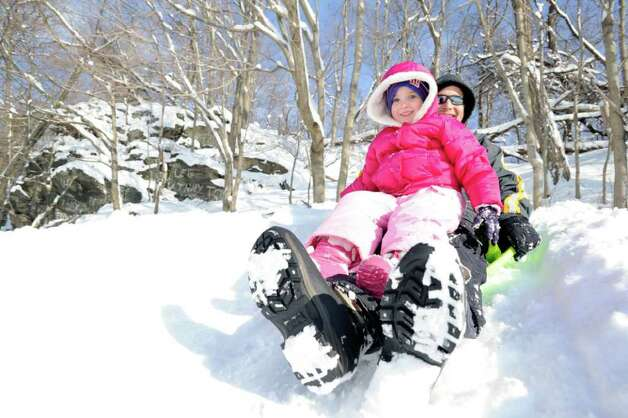 Dan Hall and his daughter, Audrey, 3, of Greenwich, have the hill in Pemberwick Park to themselves as they do some sledding, Wednesday morning, Jan. 12, 2011. Photo: Bob Luckey / Greenwich Time