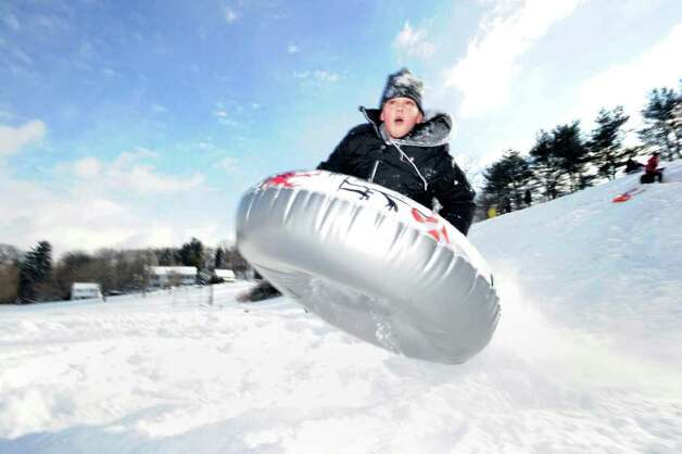 Robert Clark, 11, of Greenwich, catches some air as he takes his tube over a jump while riding on the hill near the Western Greenwich Civic Center, Wednesday afternoon, Jan. 12, 2011. Photo: Bob Luckey / Greenwich Time