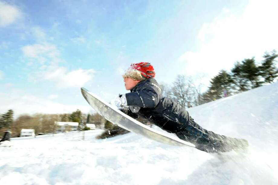 Peter Santana, 9, of Greenwich, in action riding his sled over a jump on the hill near the Western Greenwich Civic Center, Wednesday afternoon, Jan. 12, 2011. Photo: Bob Luckey / Greenwich Time