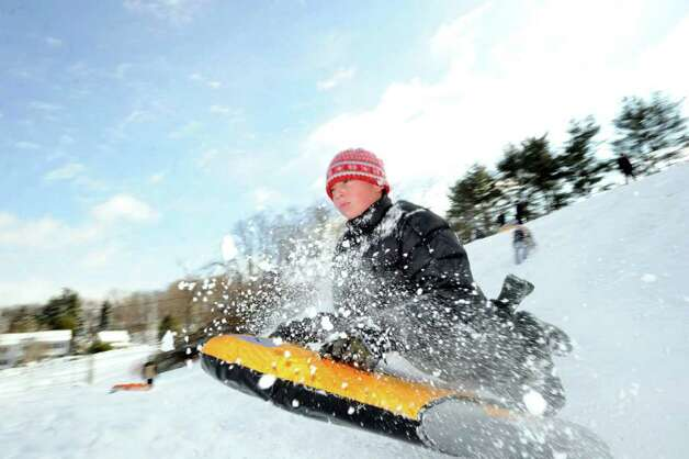 Greenwich resident Alec Miller, 12, in action riding his sled on the hill near the Western Greenwich Civic Center, Jan. 12, 2011 Photo: Bob Luckey / Greenwich Time