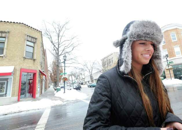 Christina Fattore, 14, styles on Greenwich Avenue with a fur hat and a smile, Wednesday afternoon , Jan. 12, 2010.  Fattore a Greenwich High School freshman, had the day off due to the snow. Photo: Bob Luckey / Greenwich Time