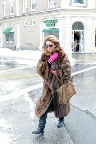 A woman wearing a fur coat makes her way north on Greenwich Ave. during the aftermath of the snowstorm, Wednesday, Jan. 12, 2011. Photo: Bob Luckey / Greenwich Time