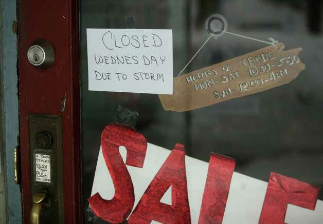 A sign marks one of many businesses closed because of the snowstorm in downtown Milford on Wednesday, January 12, 2011. Photo: Brian A. Pounds / Connecticut Post