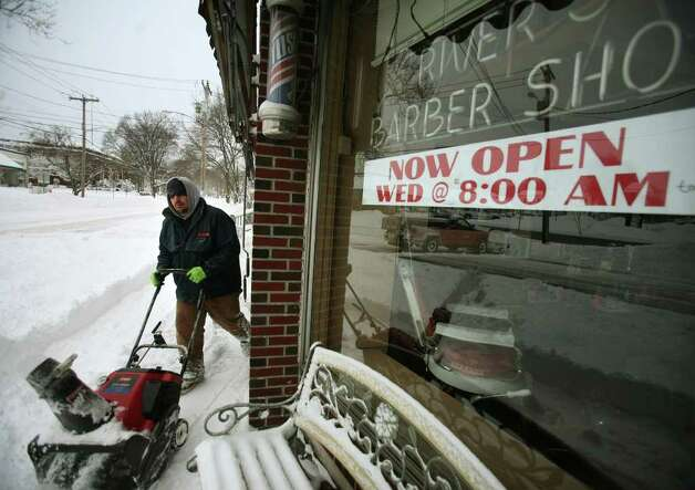 Joe Drenkhahn of Milford uses a snowblower to clear the sidewalk in front of some businesses on River Street in downtown Milford on Wednesday, January 12, 2011. Photo: Brian A. Pounds / Connecticut Post