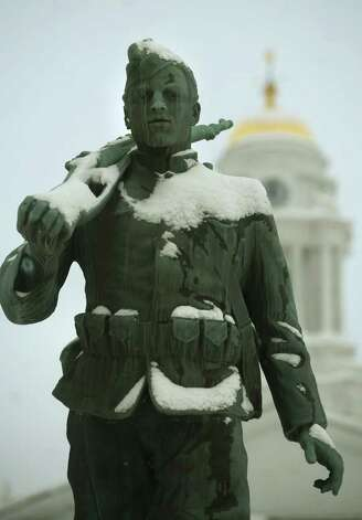 Snow covers the soldier statue in front od Milford City Hall in downtown Milford on Wednesday, January 12, 2011. Photo: Brian A. Pounds / Connecticut Post