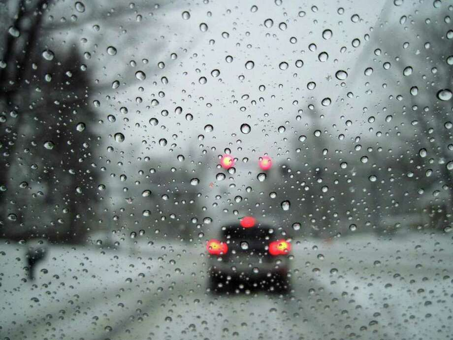 Snowflakes turn to water drops as they hit a warm windshield on Wednesday, Jan. 12, 2011.  (Paul Buckowski / Times Union) Photo: Paul Buckowski / 10011727A