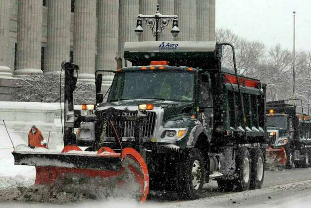 City snow plows clear Washington Avenue in front of the State Education Building in Albany on Wednesday, Jan. 12, 2011.( Michael P. Farrell/Times Union ) Photo: Michael P. Farrell
