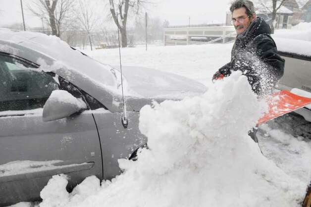 Glen Moir digs out his vehicle from the snow pushed up by plows in Rensselaer on Wednesday, Jan. 12, 2011.  (Paul Buckowski / Times Union) Photo: Paul Buckowski / 10011727A