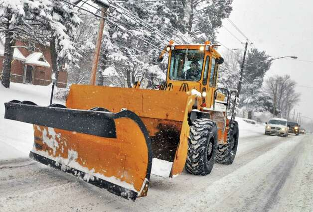 Snow removal equipment is on the move along Albany Shaker Road in Colonie Wednesday, Jan. 12, 2011.   (John Carl D'Annibale / Times Union) Photo: John Carl D'Annibale / 10011727A