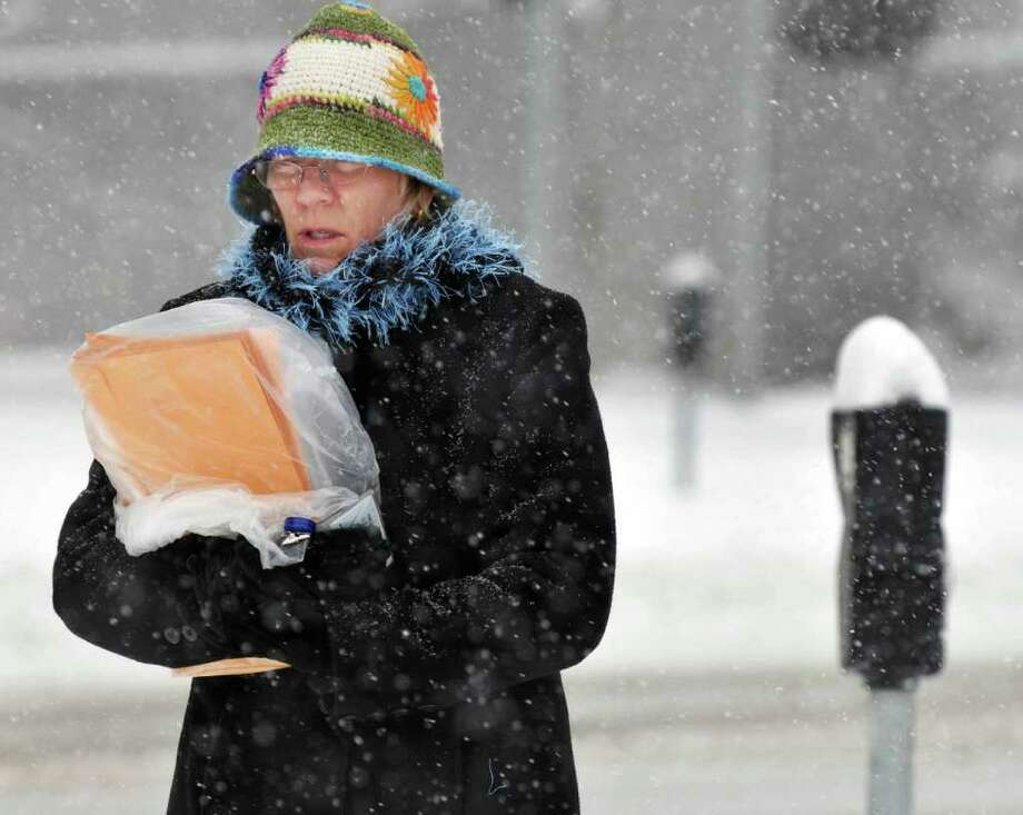 Jane Fireovid of Bethlehem makes her way along Washington Avenue in  Albany  during Wednesday morning's snow storm.   (John Carl D'Annibale / Times Union) Photo: John Carl D'Annibale / 10011727A