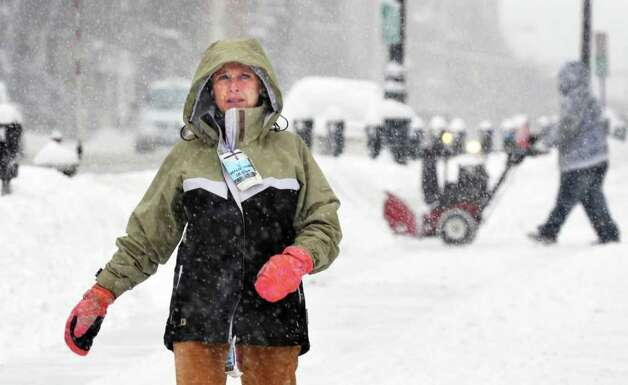 Susan Doelsnitz of Bethlehem makes her way along a snowy sidewalk in downtown Albany Wednesday morning.   (John Carl D'Annibale / Times Union) Photo: John Carl D'Annibale / 10011727A
